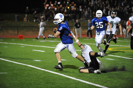 Photographer Kevin Remington captured Sitterson breaking the last tackled on a kickoff return for a touchdown.