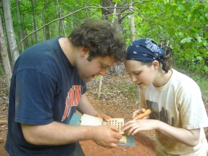 Richard Hahn '11 and Susan Payton '11 compare a sediment sample to a Munsell Color Chart